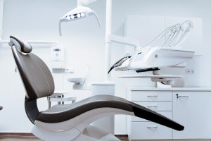Orthodontist in Glasgow Clinic with dentist chair and specialist machines