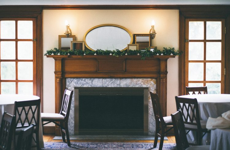 Traditional yet minimal fireplace in Glasgow with dark wood mantel and grey marble interior